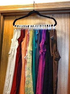Save room in your drawer by hanging your tank tops on one hanger with shower curtain rings.