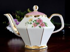 Vintage Teapot, Gibsons Tea Pot, Pink and White Stripes, Made in England. Oh! It's a cutie! Octagonal-shaped with draped gilt trim and a beautiful spray of pink Dogwoods, front and back. Two of the panels are in a washed pink color. This pot has significant clean crazing and some signs of wear and age of the gilt. That said, it's really unique and fun! I have looked it over carefully and found no chips or cracks. Clean interiors. Gilt is 85% intact and shiny. 4 Cup capacity, measures 7…