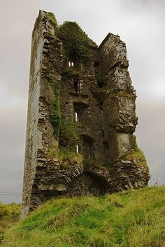 Cloondooan Castle ruins, Ireland - A partially-ruined castle, or tower house. The castle was under seige and Mahon, the owner, was killed. His people surrendered and the western side of the Castle was then razed to the ground. Abandoned Buildings, Abandoned Places, Abandoned Castles, Beautiful Ruins, Beautiful Places, Places To Travel, Places To See, Magic Places, Urbane Kunst