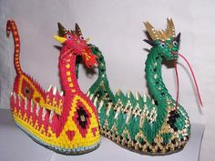 My versions of the Dragon Boat: I learned how to make these from a YouTube Video. These are my versions. I made them bigger and changed the design a bit. They were a lot of fun to make,