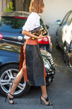 Rock a statement clutch with a crisp white button down and a color block skirt.