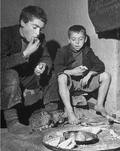 Civil War/Greece  Two young boys eating bread and tomatoes.Location:Louzesti, Greece  Date taken:December 1947  Photographer:John Phillips
