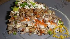 Кулинарный фото рецепт приготовления блюда -  Салат с селедкой, орехами и грибами. Нажать для увеличения.