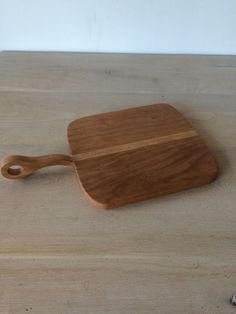 The Belmont Bread Board is a had cherry wood board with a shaker style carved circle handle. Wash and dry by hand. We recommend conditioning your cutting boards with a food grade mineral oil or walnut