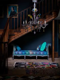 Avant-garde chaise by Matthew Williamson, paired with teal and green scatter cushions and colourful statement rug. More at http://www.redonline.co.uk