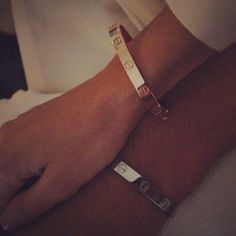 Matching his and hers Cartier love bracelet
