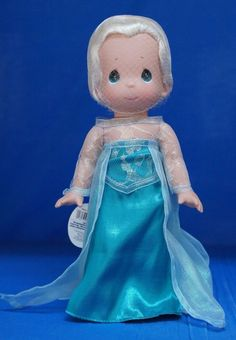 Elsa Precious Moments Disney doll! Her hair and face is in a net but the photo makes her look really stunning.