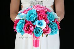 Kassy Collection This wedding bouquet has hot pink and turquoise roses accented with turquoise halo calla lilies. The hot pink handle with the love jewel is amazing. It also stands on the table so you can also use this bouquet as decor at the reception. Turquoise Wedding Flowers, Wedding Colors, Our Wedding, Dream Wedding, Wedding Things, Wedding Stuff, Teal Bouquet, Hot Pink Weddings, Budget Bride