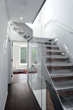 Julie Torres Moskovitz, who designed New York's first certified Passive House, recently finished her first book, The Greenest Home (Princeton Architectural Press), about the first wave of ultragreen homes in the United States (following the 40,000 already constructed in Europe). The title hits shelves in May 2013. Here, a custom stainless steel stair with treads of perforated steel replaces the old wood staircase in the rehabbed Park Slope brownstone.