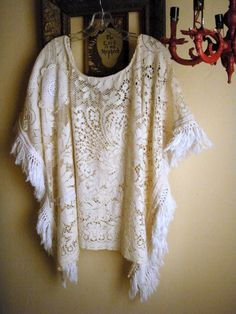 Fun poncho style lace top made from vintage linens including doilies, part of a tablecloth, vintage fringe, crochet trim, and lace. Handsewn,