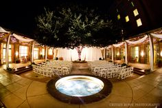 Outdoor evening ceremony at the Renaissance SouthPark.    Looking to plan your special day?  Contact our sales team at 704.998.2495.