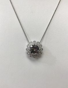 Unique. Black diamond centre with white diamond flower halo for this necklace. Great for every day or for a special evening out. Beautiful  anniversary gift.