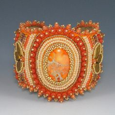 Orange Crush Cuff, Bead Embroidery, Bracelet. $400.00, via Etsy.