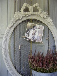 Antique frame and chicken wire bulletin board