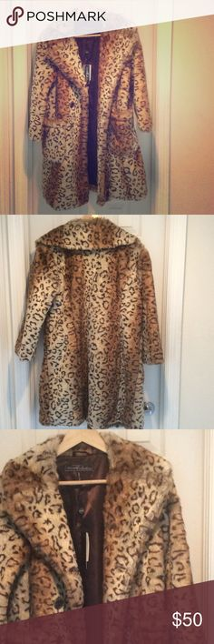 🔥Faux fur print coat🔥 Beautiful faux fur leopard print coat to add some fabulousness to your winter wardrobe! This coat is new with tags and never worn! Vigoss Jackets & Coats