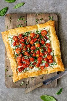 Roasted Cherry Tomato Tart with Herbed Ricotta Roasted Cherry Tomato Tart with Herbed Ricotta – Overhead shot of tart on wood cutting board before being sliced Tart Recipes, Appetizer Recipes, Appetizers, Cooking Recipes, Steak Recipes, Shrimp Recipes, Kitchen Recipes, Rice Recipes, Soup Recipes