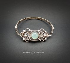 Unique wire wrapped Silver bracelet with pearls and aqua chalcedony. The metal has been oxidized to give it a more antique and magical look.  size: girth of 20cm!   All jewellery are made by my hand on my own sketches.  After sending, Ill provide the tracking number and you will be able to track all the movements of the parcel.  Color accuracy depends on the individual settings of your monitor