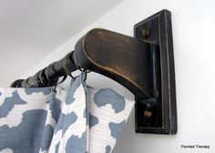 DIY: Curtain rods from outdated/cheap towel hangers!  Just repaint and hang! (Or My idea: purchase longer wooden dowels from improvement store,cut to needed length, & paint to match!)