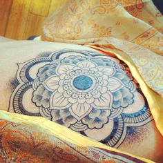 Mandala flower with dot work.