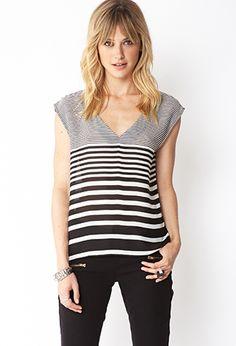 Standout Striped Chiffon Top. A semi-sheer chiffon top featuring a gradated stripe pattern. V-neckline. Cutout back. Sleeveless. Unlined. Woven. Lightweight.