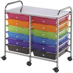 This rolling cart is ideal for storing large and small tools; embellishments; punches; stamps; paper and more. The chrome frame and locking swivel casters are sturdy and stylish combined with the multi-colored drawers. This cart contains twelve drawers
