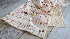 Baby is sure to snuggle with this arrow minky blanket for years to come. Super stylish and modern tribal baby blanket will make a great addition to any tribal nursery. This cream minky blanket is supe