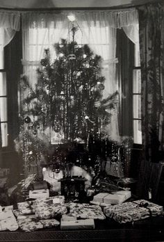 40s Christmas tree - - So some folks did get a lot of presents back then or this was a really large family.