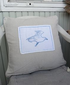 Simple seagull embroidery and tassels to corners.