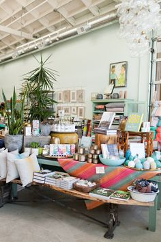 A must visit spot when in Portland, OR - Spring 2015 at @inkandpeat - A full table - all the best for Spring - cookbooks, handmade blankets, and Illume bodycare and candles. Photo by Linnea Paulina. http://www.inkandpeat.com/retail.html