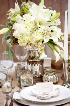 white floral centerpiece with mercury glass.