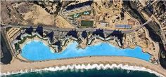Chile's 250,000 cubic meter pool at San Alfonso del Mar is so large, tourist can sail their boats in it. Its been acknowledge buy Guiness at the world's largest pool. it holds as much water as 6,000 standard pools. designed by bio chemist Fernando Fischmann.  walking on sunshine:-)