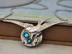 TIME TO Be FREE antique silver steampunk watch movement sparrow necklace with Swarovski rhinestone. $43.50, via Etsy.