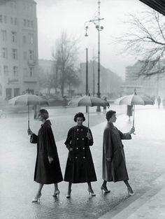 ladies and umbrellas by F.C Gundlach