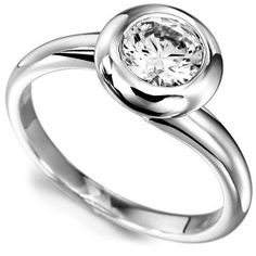 Domed Bezel Round Solitaire Twist Engagement Ring. Features a round brilliant cut diamond in a substantial ring design with court shaped band.
