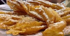 Farturas is a traditional Portuguese dessert that is a combination of funnel cake and churros and is very popular in Portugal. Portuguese Sweet Bread, Portuguese Desserts, Portuguese Recipes, Portuguese Food, Portuguese Culture, Learn Portuguese, Donut Recipes, Cake Recipes, Dessert Recipes