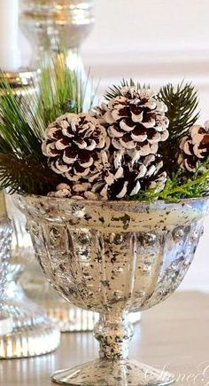 Mercury glass and dipped pine cones with a little greenery makes a beautiful wintery arrangement. | #Christmas #Decorations #Indoor Sherman Financial Group