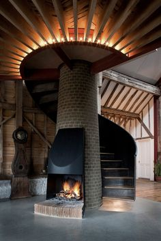Fireplace - spiral staircase all in one #stunning #stair #design
