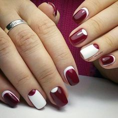 Minimalist inspired maroon nail art design. The alternating white and maroon nail polish makes the nail art design pop out and have its own attitude.