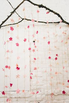 DIY wedding backdrop - photo by Jenn Byrne Creative http://ruffledblog.com/diy-paper-cherry-blossom-backdrop