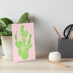Galeriedruck für deinen Schreibtisch   Kaktus   für den Schulanfang   Unistart   neues Schuljahr   Home Office   Deko   grün   pink   Sukkulente   Linocut Cacti #1 Minty Pinky von Bianca Green