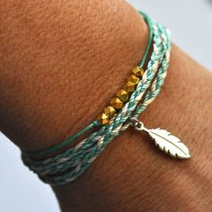 Wish bracelet beaded on sage green waxed linen cord with gold nuggets. $26.00, via Etsy.