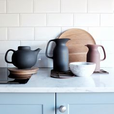 Tea time! Olio matte stoneware & wooden platters by Royal Doulton designed by Barber & Osgerby, wood trivets from Ferm Living