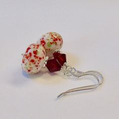 Lampwork glass and red Swarovski crystal sterling silver earrings. by Craftybeadsbysam on Etsy https://www.etsy.com/uk/listing/514482215/lampwork-glass-and-red-swarovski-crystal