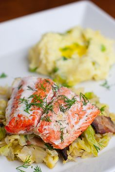 "Roasted salmon,cabbage & bacon:  6 slice bacon,cut 1"" pieces;1 onion, dice;1 head cabbage,chop;1-1 1/2c water;2tsp fresh dill;1&1/2 lbs salmon filet,skin removed;4tsp olive oil;4tsp butter;S to taste.Preheat to 300. Cook bacon not crispy.Drain all but 4 TBS fat.Add onion,cook til soft.Add cabbage,water.Cook til tender & water evaporates.Meanwhile,salmon on non stick bake sheet.Drizzle w/oil.Season with S,1tsp dill.Butter on top. Cook @ 300 for 15-20 min or till done  Serve with cabbage"