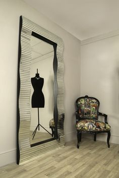 A spectacular large wavy unusual Venetian mirror that has strips of glass mounted on a curved glass frame.
