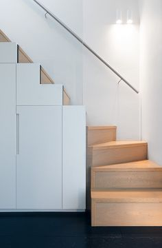 Loft conversion, Azman Architects on Flickr see how stairs #5 and up are all cupboards for storage.