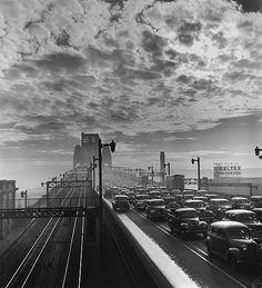 David Moore's photo of early morning traffic crossing the Sydney Harbour Bridge, 1947. v@e.