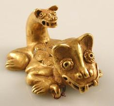 """Gold Pendant of a Jaguar with a Head on its Tail - FJ.6049, Origin: Costa Rican/Panamanian Border Area, Circa: 500 AD to 1550 AD, Dimensions: 3.25"""" (8.3cm) depth, Catalogue: V21, Collection: Pre-Columbian, Style: Pre-Columbian, Medium: Gold. The jaguar has had great mythological significance in Pre-Columbian art from the earliest Olmec civilization. The great cat, both beautiful and fierce, has been the subject of devotion and admiration for centuries."""