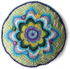 beautiful colors. pattern for sale. Lovely site with lots of inspiration for crochet, felt, folk art.