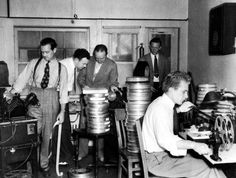 Full shot of editors supervised by Hal C. Kern cutting picture down to 222 minutes. Victor Fleming, Margaret Mitchell, Film Reels, Turner Classic Movies, Vhs To Dvd, Olivia De Havilland, Gone With The Wind, Will Turner, Scene Photo